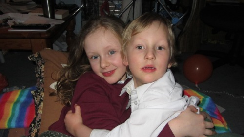This is a photograph of Darlek with her brother, just before they went to school.  Sausage looks like he's trying to get away, I think it was another of those boa constrictor hugs.