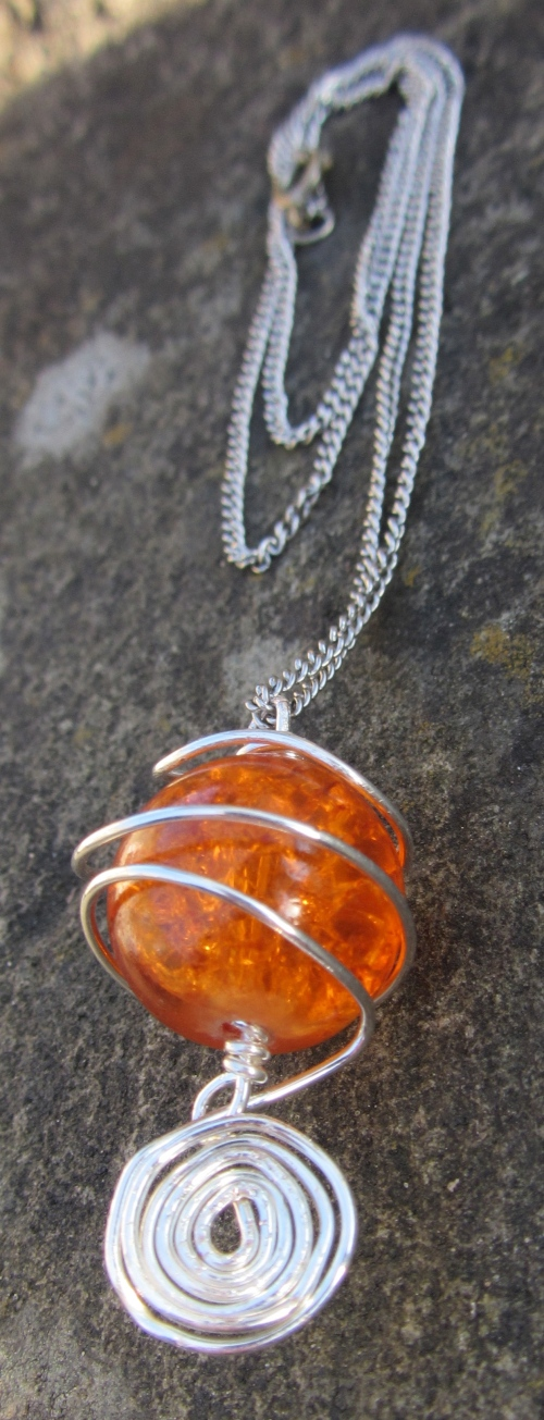 Crystallized sunset swirled with silver beading wire.