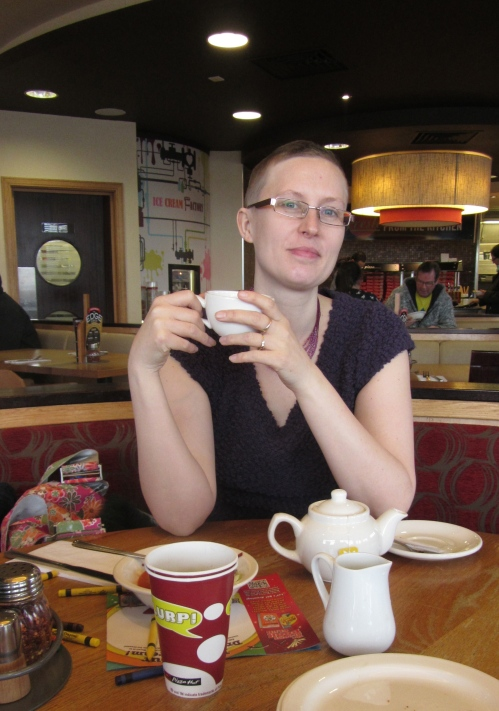 The elegant skinhead downing a  cup of tea look.