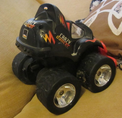 Remote controlled cars rarely work at our house.  (and yes, this has mucky wheels and is on my sofa. Grrrr....)