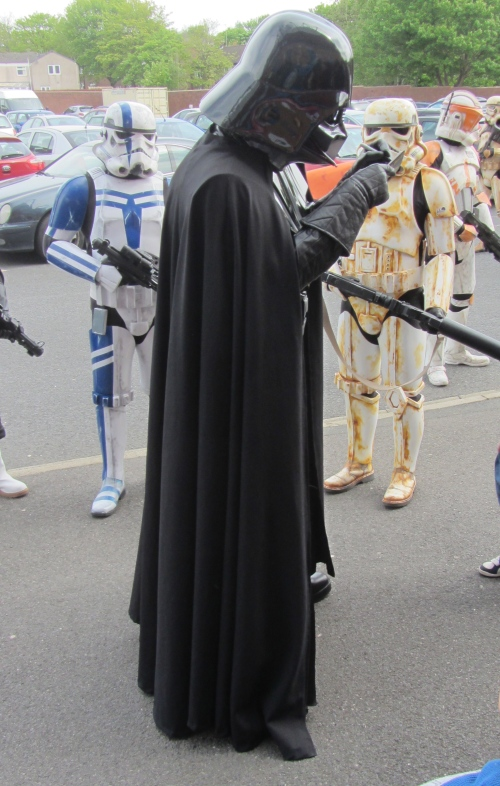 Tall and intimidating, Darth Vader strode through the crowds, signing autographs and wheezing.