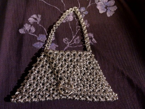 A little chainmaille bag made in a japanese weave.  Cute and little.