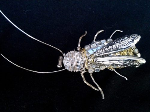 A 'Clockroach' made out of an alarm clock I pulled in pieces, two silver beads and a bit of wire.