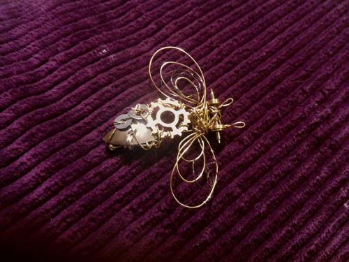 I 'sewed' some of the clock to a wirework bee I made.  All held in place with the wire you can sometimes find wrapped around corked wine bottles.