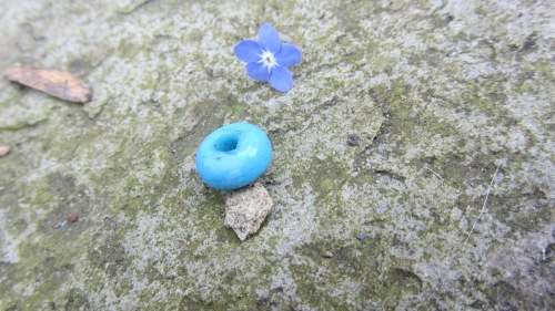 A turqouise glass bead I found by a riverbank on a dog walk.  An archaeologist friend of mine said that beads such as this can sometimes be from the iron age, but then again, it could just as easily be from a broken bracelet from Accessorize, lost on a sunny day spent by the river. Who knows?  I like it.